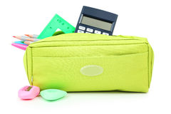 Pencil case full of school supplies isolated on white. Stock Images