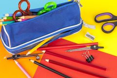 Pencil case and pencils on a colourful card background Stock Images