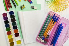 A pencil case, pens, pencils, notebook, notebooks lie on the tab. Le. Stationery school accessories Stock Photo