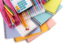 Pencil case, school supplies with calculator, pile of books isolated on white background Royalty Free Stock Images