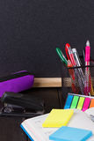 Pencil case with various stationery on old wooden table Stock Photos