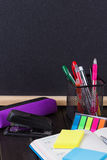 Pencil case with various stationery on old wooden table Stock Image