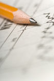 Pencil on chart Royalty Free Stock Images