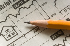 Pencil on chart Stock Images