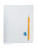 Pencil on checked notebook  on white Stock Images