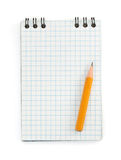 Pencil on checked notebook  on white Stock Image