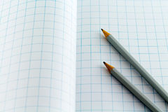 Pencil on Checkered background Royalty Free Stock Image