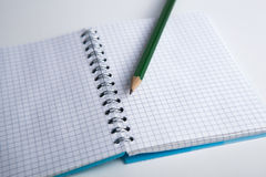 Pencil on the checkered paper exercise book Stock Photo