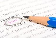 Pencil circle highlight on word love Stock Photos