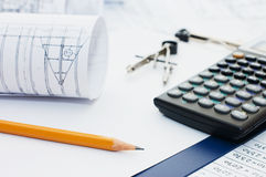 Pencil on clipboard and the calculator Stock Photography