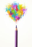 Pencil close-up with colored paint splashes Royalty Free Stock Photography