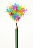 Pencil close-up with colored paint splashes Royalty Free Stock Photo