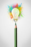 Pencil close-up with colored paint splashes and lightbulb concept. Colored pencil close-up with colored paint splashes and lightbulb concept Royalty Free Stock Images