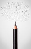 Pencil close-up with sketchy arrows. Coloured pencil close-up with sketchy arrows Royalty Free Stock Photos