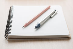 Pencil and clutch-type pencil on notebook. Stock Images