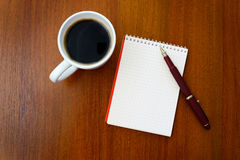 Pencil, coffee, notebook Stock Photo