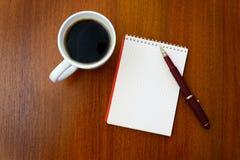Pencil, coffee, notebook stock photo