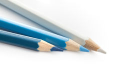 Pencil color navy blue white. Wooden background Stock Photos