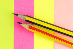 Pencil on colored paper Royalty Free Stock Photography
