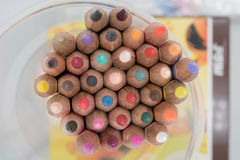 Pencil. Colored pencils background. Set of colored pencils in the holder on the table background, top view Royalty Free Stock Image