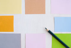 Pencil and colored post Stock Photography