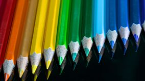 pencil colors on a black glass macro stock image