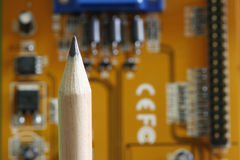 Pencil - computer card. A pencil and a network card as background Royalty Free Stock Photo