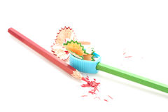 Pencil Crayon And Sharpener On White Background. Stock Images