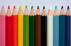 Pencil crayons. Colorful rainbow of pencil crayons or back to school image Stock Photos
