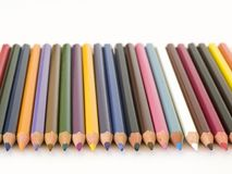 Pencil Crayons. In a line stock images