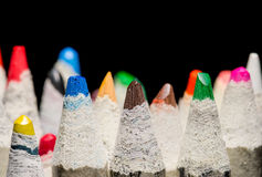 Pencil crayons on black. Image of many pencil crayons on black stock photo