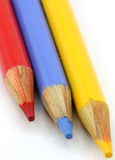 Pencil crayons, red, blue yellow primary portrait Royalty Free Stock Photography