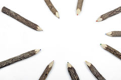 Pencil Crayons Set in Bark Arranged in Circular Pattern. Above studio shot of pencil crayons set in bark arranged in circular pattern on white Royalty Free Stock Image