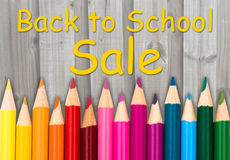 Pencil Crayons with text Back to School Sale. With weathered wood background Stock Photography