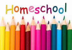 Pencil Crayons with text Homeschool. Isolated over white Royalty Free Stock Photo