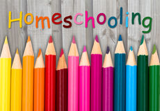 Pencil Crayons with text Homeschooling Stock Photography