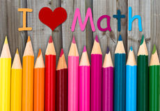 Pencil Crayons with text I love Math. With weathered wood background royalty free stock images