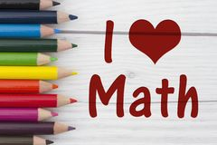 Pencil Crayons with text I love Math. With weathered wood background royalty free stock photos