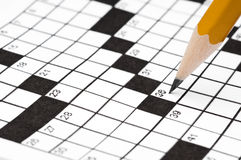 Pencil on a crossword puzzle Stock Photo