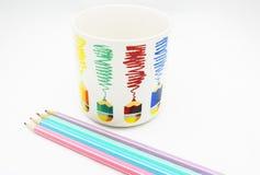 Pencil and cup Stock Photos