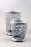Pencil cups. Two empty pencil cups (big and small) made of grey wire stock photos