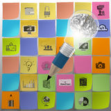 Pencil 3d light bulb with metal brain. Draws icons of business strategy on sticky note as concept Royalty Free Stock Photography