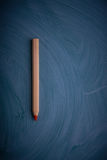Pencil on a dark background. Royalty Free Stock Images