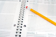 Pencil and day planner Stock Photography