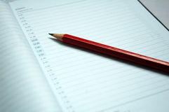 Pencil and diary Royalty Free Stock Images