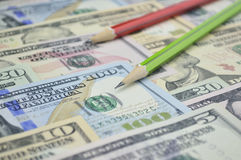 Pencil on dollar bank note money Stock Photography
