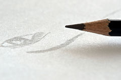 Pencil and a draw. Picture of a pencil and a draw royalty free stock photo