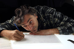 Pencil drawing animator. Worker of the cartoon animation industry on lightbox royalty free stock photography