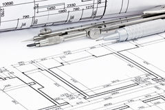Pencil with drawing compass and rolled plans of architectural bl Royalty Free Stock Photos