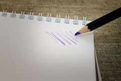 Pencil drawing in Notepad. Purple pencil drawing in Notepad Stock Images